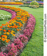 Colourful Flowerbeds and Winding Grass Pathway in an...