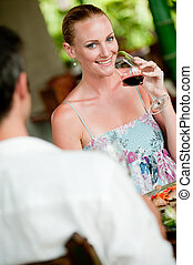 Woman Drinking Wine - A beautiful woman drinking wine whilst...