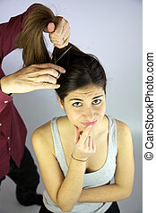 Do I want to cut my long hair? - Woman thinking about...