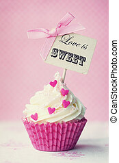 "Valentine cupcake - Cupcake with ""love is sweet"" pick"