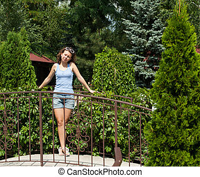 cute girl - Photo of a beautiful and cute girl standing in...