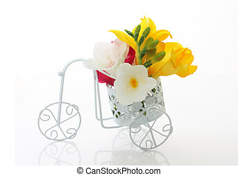 Beautiful freesia flowers  in cute vintage bike over white