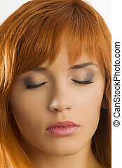 close eyes - red haired woman showing make up keeping closed...