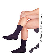 Male legs in black socks Isolated on white background