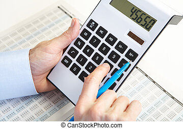 The businessman and calculator - Businessman working with...