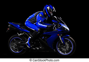 Motorcyclist in blue equipment and helmet on black...