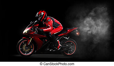 Motorcycliston black background side view full length -...
