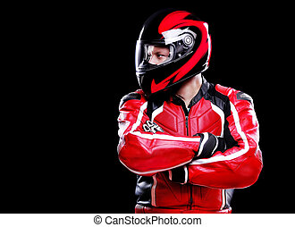 Motorcyclist in red equipment and helmet on black background...