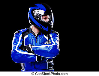 Biker in blue jacket and helmet on black background looking...