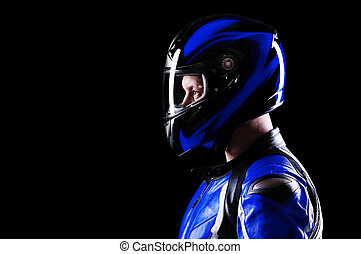 closeup portrait of a biker blue equipment on black side...