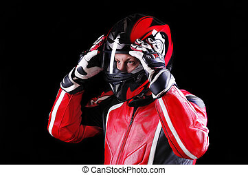 closeup portrait of a biker holding his helmet with both...