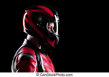 closeup portrait of a biker on black side view