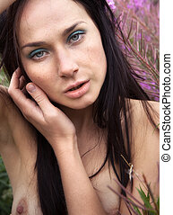 Seminude beautiful girl among the flowers - Portrait of...
