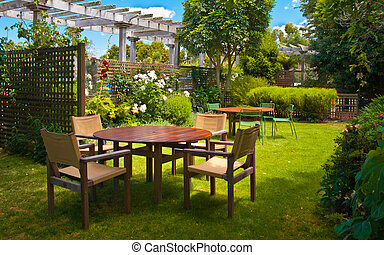 Dining Table set in Lush Landscaped Garden - Landscaped...