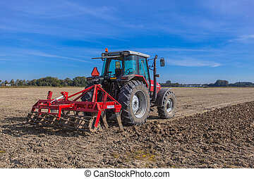 Working Tractor with Plough - Farming in the Netherlands,...
