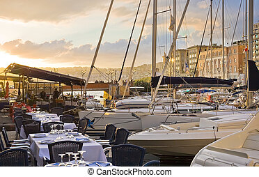 Naples at sunset - Beautiful restaurant in the port of...