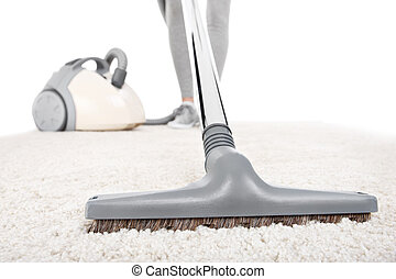 Vacuuming carpet - A picture of a carpet being vacuumed over...