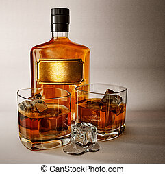 whiskey in the glass bottle and two glasses