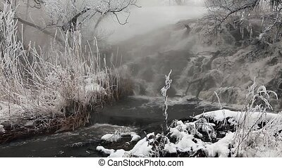 Frozen stream with waterfall