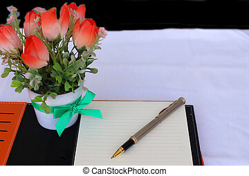 notebook , pen and flower