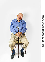 happy elderly man sitting in a chair - happy elderly man...