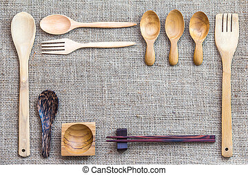 Kitchen Utensil - Wooden kitchen utensil on Sackcloth...