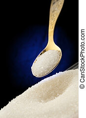 White sugar and spoon - Heap of white sugar and spoon