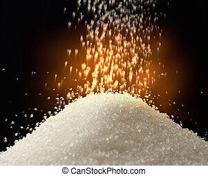 Flow of white sugar on black