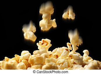 Popcorn falling down on black background