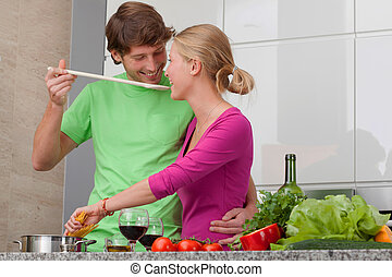 People in love making spaghetti - Young people in love...