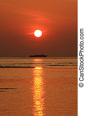 Red sunset with golden light effect