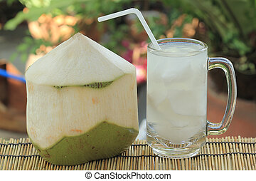 Coconut Juice - Fresh coconut and a cup of the juice