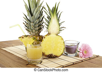 Glass of pineapple juice and pineapple