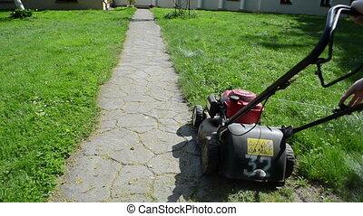 worker start grass mower