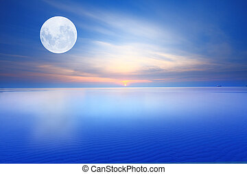 Surreal full moon over sunsrise blue sea and sky ,Long...