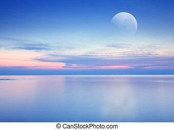 Beach sunrise with dramatic sky, sea and moon background