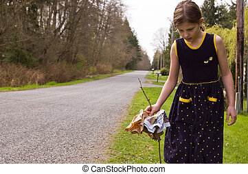 Female Child is Picking up Litter - 8 year old Caucasian...