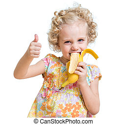 kid girl eating banana and showing ok sign