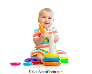 happy baby girl playing with colorful toy isolated on white