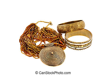 two bronze bracelets and a necklace on a white background