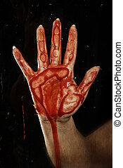 bloody hand on glass - closeup of bloody hand on glass