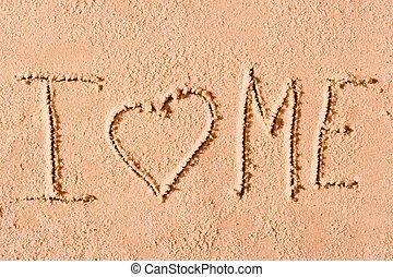 I love me written on wet sand