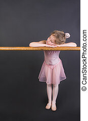 Tiny Ballerina - Young ballet dancer wearing an apricot tutu