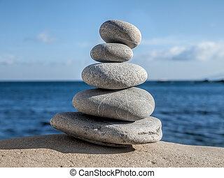pebble zen - Stones pyramid symbolizing zen, harmony,...