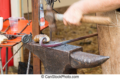Black Smith Hammering - Rod of iron getting hammered in to...