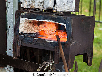 Black Smith Oven - Small black smith oven with iron work...