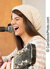 girl singing loud and playing guitar - girl singing loud...