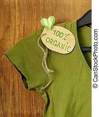 green shirt with organic label on a hanger