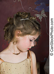 Flower Girl - Blond Flower girl wearing a golden dress with...