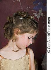 Flower Girl - Blond Flower girl wearing a golden dress with...